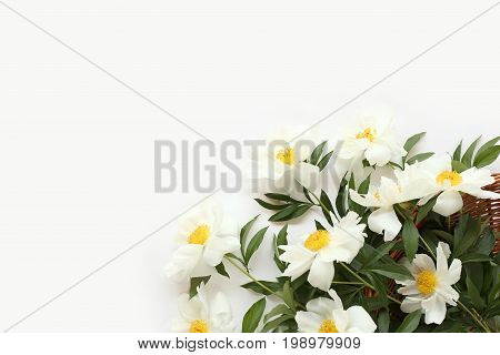 Wicker Basket Of Flowers On A Light Background, Beautiful Fragrant Bouquet Of Peonies - Top View.