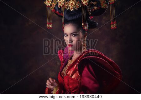Asian woman in Chinese tradition dress.Queen red dress.