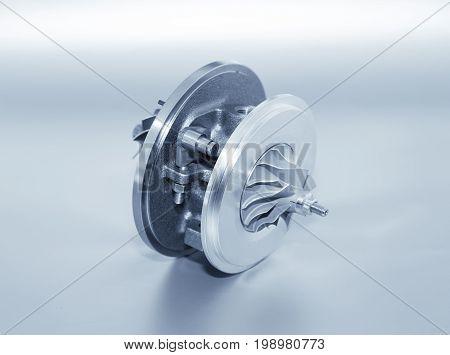 Turbocharger On Metallic Background. Car Turbine - Part Of Engine. Blue Toned.