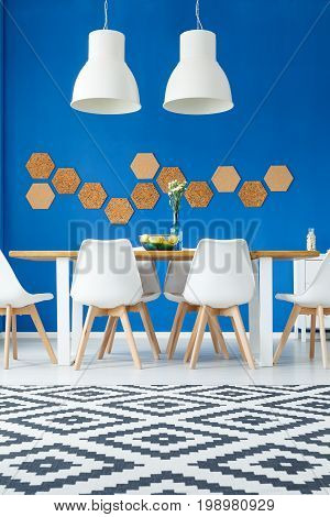 Dining Room With Patterned Rug