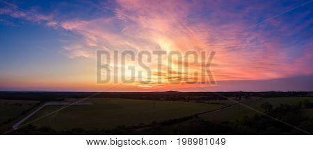 Missouri sunset over farmland in a rectangle format