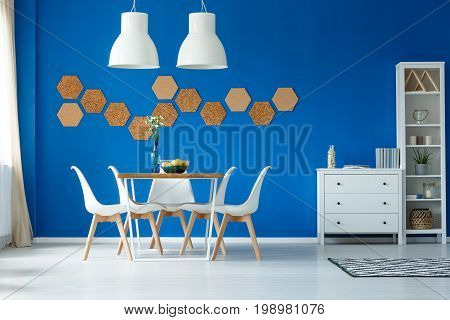 Blue Walls And Simple Furniture