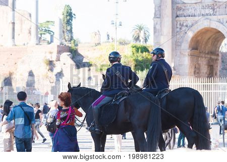 ROME ITALY - OCTOBER 16 2016: Two italian police men on horses at the collosseum