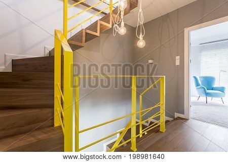 Wooden Staircase With Yellow Railing