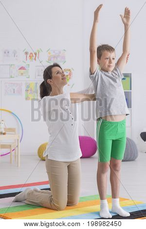 Boy Exercising With Physiotherapist