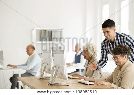 Tutor Helping Woman With Computer