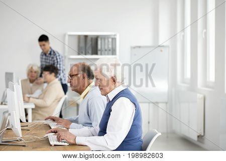 Elder Men Using Computers