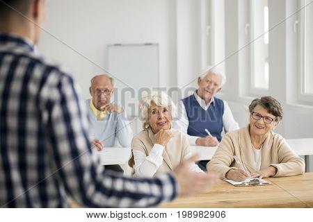Women And Men Making Notes