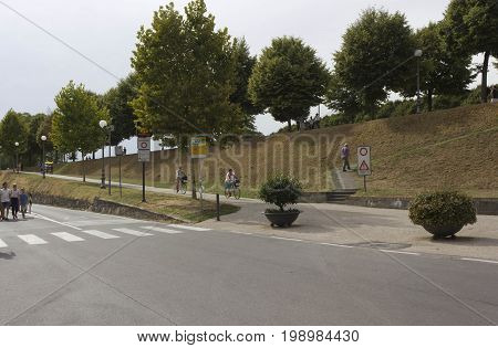 LUCCA, ITALY - AUGUST 15 2015: Pedestrian and cyclist footpath on the boundaries of Lucca city in Tuscany Italy