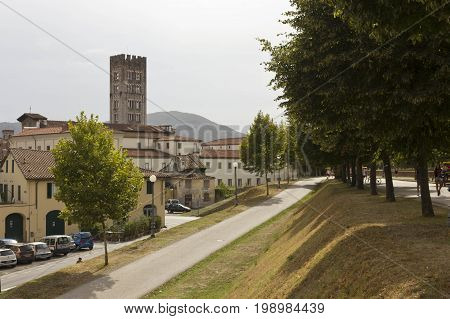 LUCCA, ITALY - AUGUSt 15 2015: Pedestrian path surrounding Lucca fortified walls boudaries