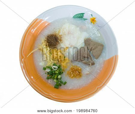 Minced Pork Congee with preserved egg and Fresh Ginger and Vegetable Serve with Deep-fried Dough Stick, a Chinese - Thai Breakfast isolated on white background