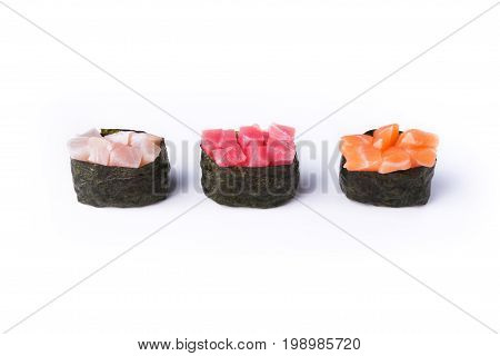 Set of three gunkans isolated at white background. Salmon, tuna and seebas sushi. Asian healthy restaurant food delivery