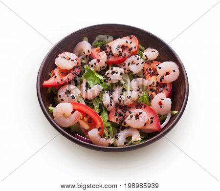 Healthy japanese restaurant food isolated at white. Bowl of shrimps and iceberg lettuce, tomatoes salad with red onion and black sesame. Asian cuisine