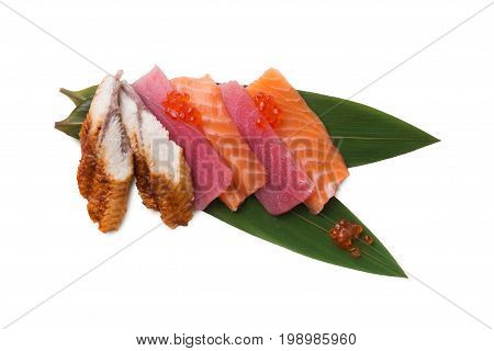 Tradional japanese food isolated at white background. Restaurant serving of fresh raw salmon, tuna, eel and caviar on bamboo leaf. Asian meals delivery