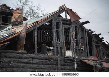 Abandoned wooden house after fire accident concept insurance