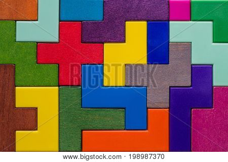 Abstract Background. Background with different colorful shapes wooden blocks. Geometric shapes in different colors. Concept of creative logical thinking or problem solving.