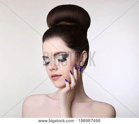 Beauty Makeup Girl. Fashion Bun Hairstyle. Manicure Nail. Young