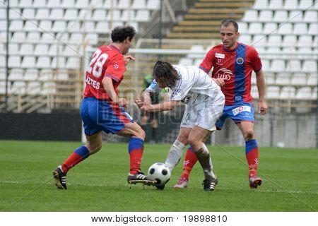 KAPOSVAR, HUNGARY - APRIL 1: Krisztian Lisztes (L) in action at a Hungarian National Championship soccer game - Kaposvar vs Vasas on April 1, 2011 in Kaposvar, Hungary.