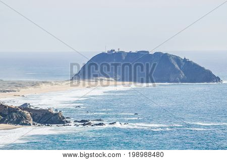 Central California Coast With Beach, Cliffs, Island, Lighthouse And Blue Ocean In Big Sur