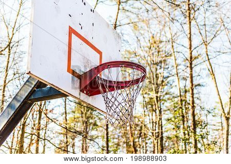 Closeup of red basketball hoop in playground