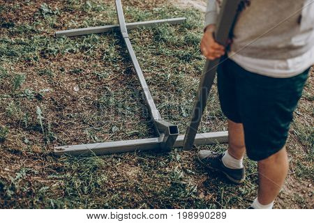Strong Handsome Man Constructing Hammock Support Bars, Father Putting Together Hammock For Camping T