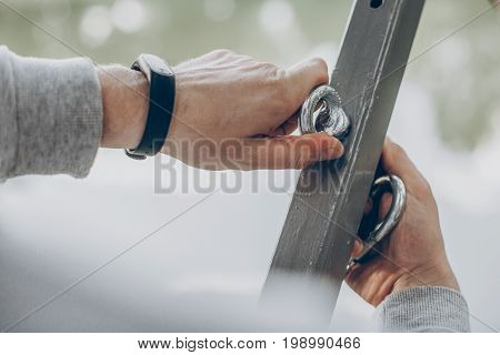 Man Putting Together Hammock, Hands Applying Hook For Hammock Hanging Close-up, Instruction Manual C