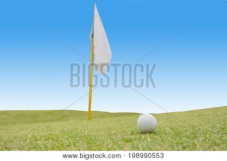 Golf course in the countryside, Green field with a flagstick