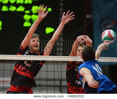 KAPOSVAR, HUNGARY - APRIL 3: Krisztian Csoma (L) blocks the ball at a Hungarian National Championship volleyball game Kaposvar vs. Kazincbarcika, April 3, 2011 in Kaposvar, Hungary.