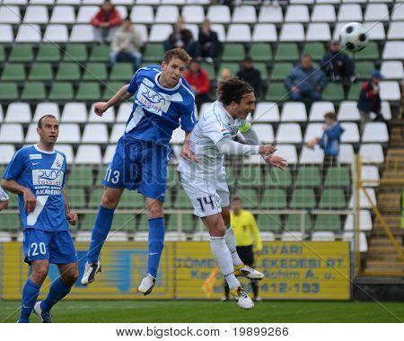 KAPOSVAR, HUNGARY - APRIL 16: Lorant Olah (R) in action at a Hungarian National Championship soccer game - Kaposvar vs MTK Budapest on April 16, 2011 in Kaposvar, Hungary.