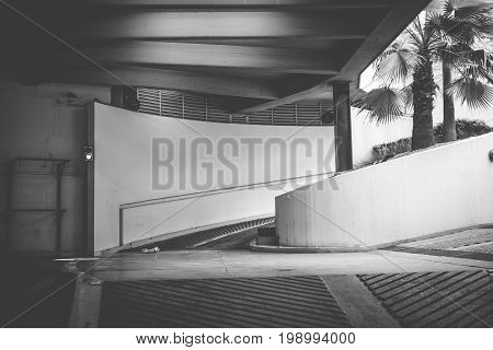 Underground parking for cars. Black and white photography.