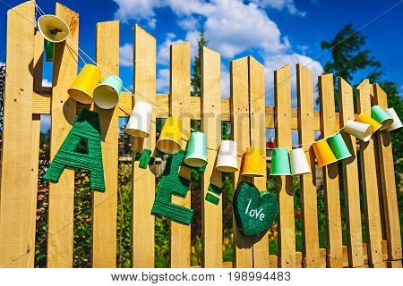 Garland Fair Bulbs. Wedding, Party Decoration. Garland Of Paper Cups Hangs On Wooden Boards. Close-u