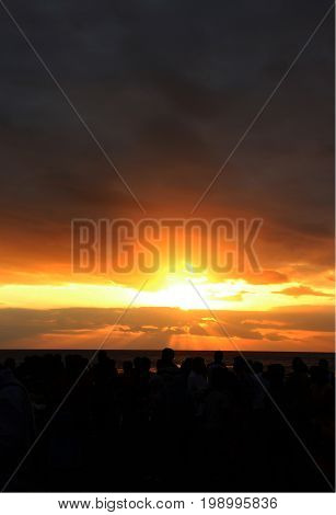 Bali, Indonesia - 23 June 2012   Sunset of Kuta Beach with Silhouettes of People Enjoying It