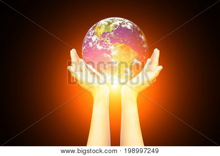 Earth in the hands isolated on black background. Elements of this image furnished by NASA. Space art. Astronomy and science concept. Earth day themeHand with planet earthElements of this image furnished by NASA.