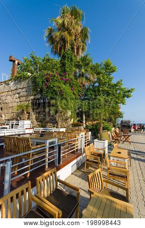 SIDE TURKEY - JULY 07 2015: Waterfront seaport. Side - Greek and later Roman city on the Anatolian coast. Founded in the 7th century BC.
