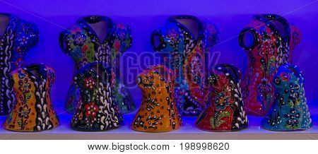 SIDE TURKEY - JULY 07 2015: Souvenir shop on the waterfront. Souvenirs with the traditional pattern of folk motives. Anatolian coast - a popular holiday destination in summer of European citizens.