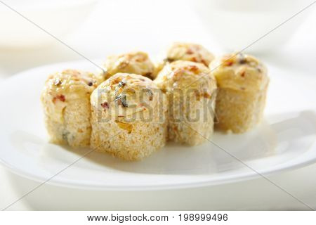 Hot Unagi Maki Sushi - Sushi Roll with Smoked EelTopped with Baked Cheese. Sesame outside