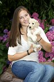 Pretty Teen holding a Golden Labradoddle Puppy poster