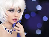 Beauty makeup. Manicured nails. Bob Blond Girl. Fashion jewelry. Fashionable Portrait Woman. White Short Hair. Gems necklace. Face Close up. Hairstyle. Fringe. Vogue Style. poster