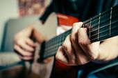 young musician playing acoustic guitar live music background poster