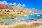 The evaporated salt. Reduced water in the very salty Dead Sea. Dead Sea, Israel. The concept of medical and ecological tourism poster