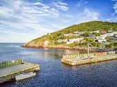 Beutiful Petty Harbour with two piers during summer sunset Newfoundland and Labrador Canada poster