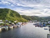Charming Petty Harbour with green hills and colorful wooden architecture Newfoundland Canada poster