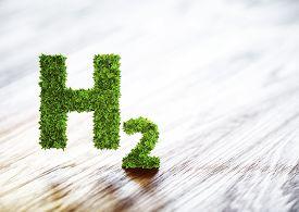 Green Hydrogen Element Sign On Blurred Wooden Background. 3D Illustration.