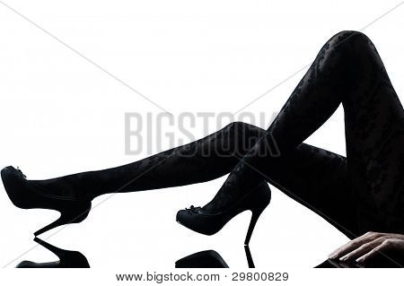 one woman legs silhouette on studio isolated white background