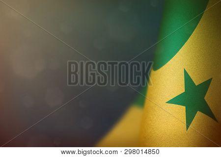 Senegal hanging flag for honour of veterans day or memorial day on light blue dark velvet background. Senegal glory to the heroes of war concept. poster