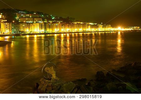 Baiona; Nigh Landscape  With Light Reflected In Water