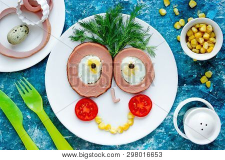 Funny And Healthy Breakfast Idea For Kids - Fried Egg, Sausage And Vegetables Cute Face On Plate