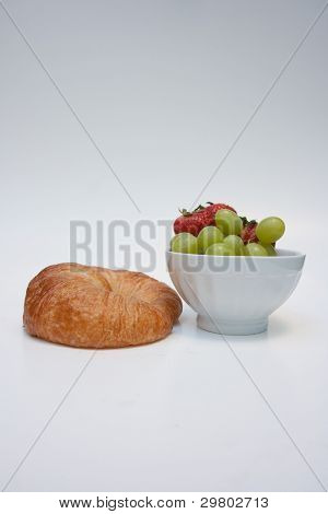 Fruit and croissant for breakfast