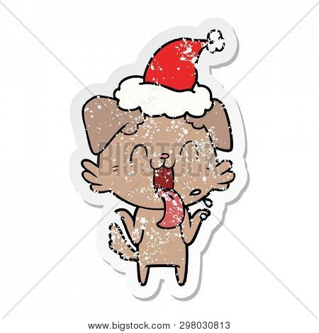 hand drawn distressed sticker cartoon of a panting dog shrugging shoulders wearing santa hat
