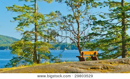 Picnic bench at beach of Saltery Bay, Vancouver, Canada.